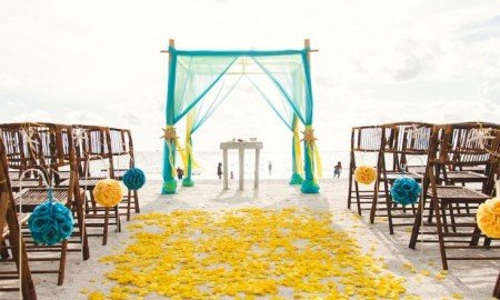 Wedding Beach Destinations: This is a Yellow and Turquoise Beach Wedding Ceremony Decor Idea. Check out more romantic beach wedding destinations on Worthminer.com